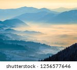 blue mountain ranges. valley in ... | Shutterstock . vector #1256577646