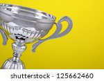silver winners cup on yellow... | Shutterstock . vector #125662460