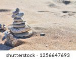 cairn on sand  stones on sand ... | Shutterstock . vector #1256647693