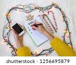 female hands over a notepad  a... | Shutterstock . vector #1256695879