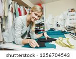 tailoring and sewing. female... | Shutterstock . vector #1256704543