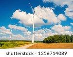 turbines on field on cloudy... | Shutterstock . vector #1256714089