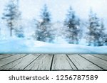 Wooden Surface With Snow And...
