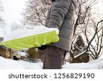 man shoveling and removing snow ... | Shutterstock . vector #1256829190