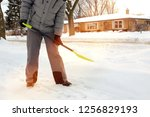 man shoveling and removing snow ... | Shutterstock . vector #1256829193