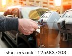 man is paying his parking using ... | Shutterstock . vector #1256837203
