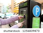 woman is paying his parking... | Shutterstock . vector #1256839873