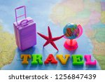 suitcase  red sea star   globe... | Shutterstock . vector #1256847439