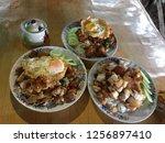 rice and stir fried crispy pork ... | Shutterstock . vector #1256897410