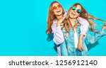 two young beautiful blond... | Shutterstock . vector #1256912140