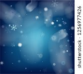blue realistic vector snowfall. ... | Shutterstock .eps vector #1256977426