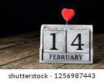wooden calendar show of... | Shutterstock . vector #1256987443