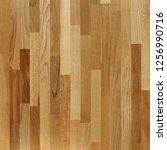 fragment of parquet floor.    Shutterstock . vector #1256990716