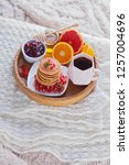 pancakes breakfast in bed... | Shutterstock . vector #1257004696