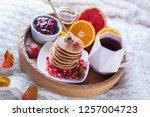 pancakes breakfast in bed... | Shutterstock . vector #1257004723
