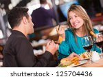 friends eating at a restaurant  ... | Shutterstock . vector #125704436