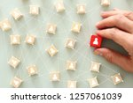 Small photo of image of wooden blocks with people icon over mint table,building a strong team, human resources and management concept - Image
