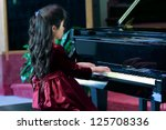 Child Playing Grand Piano In...