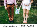 young parents hold baby romper. ... | Shutterstock . vector #1257104839