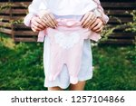 young parents hold baby romper. ... | Shutterstock . vector #1257104866
