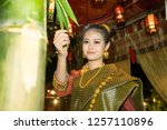 lao girl dressed in traditional ... | Shutterstock . vector #1257110896