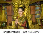 lao girl dressed in traditional ... | Shutterstock . vector #1257110899