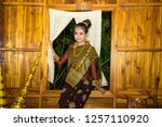 lao girl dressed in traditional ... | Shutterstock . vector #1257110920