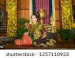 lao girl dressed in traditional ... | Shutterstock . vector #1257110923