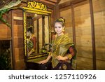 lao girl dressed in traditional ... | Shutterstock . vector #1257110926