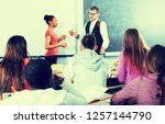 students listening the... | Shutterstock . vector #1257144790