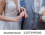 bride dresses the bridegroom a... | Shutterstock . vector #1257199240
