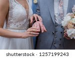 bride dresses the bridegroom a... | Shutterstock . vector #1257199243