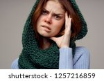 ailing woman with red nose on... | Shutterstock . vector #1257216859
