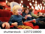 cute toddler boy watching... | Shutterstock . vector #1257218800