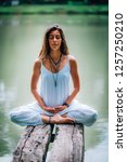 Young Woman Meditating With He...