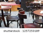 chair and tables in outdoor cafe | Shutterstock . vector #1257253189