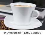 coffee cup on a table with... | Shutterstock . vector #1257320893