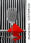a goblet with striped... | Shutterstock . vector #1257339133