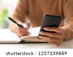 close up of lady writing out...   Shutterstock . vector #1257339889