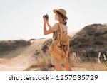 stylish young woman in khaki... | Shutterstock . vector #1257535729