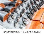 fresh seafood on crushed ice at ... | Shutterstock . vector #1257545680