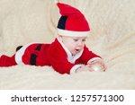 baby boy in santa costume... | Shutterstock . vector #1257571300