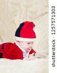 baby boy in santa costume... | Shutterstock . vector #1257571303