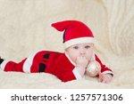 baby boy in santa costume... | Shutterstock . vector #1257571306