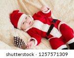 baby boy in santa costume... | Shutterstock . vector #1257571309