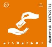 receiving credit card. hand...   Shutterstock .eps vector #1257603766