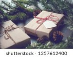 christmas gift box with note... | Shutterstock . vector #1257612400