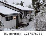 wonderful white house in snowy... | Shutterstock . vector #1257676786