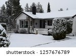 wonderful white house in snowy... | Shutterstock . vector #1257676789