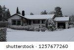 wonderful white house in snowy... | Shutterstock . vector #1257677260